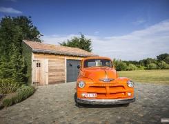 Houten autogarage + een nieuwe auto, een perfect duo
